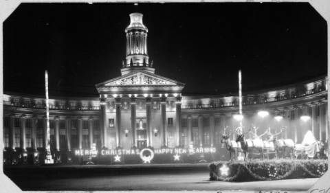 Holiday lights decorate Denver's City and County Building and Civic Center Park in this photo taken in 1940.